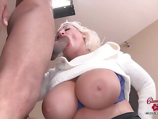 Voluptuous blonde cock sucker with massive tits is holding her legs spread wide while getting fucked